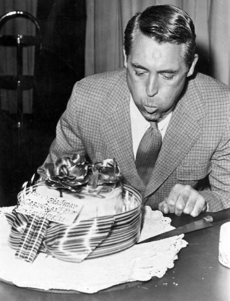 """I better blow out these candles before they set fire to the house. I wonder if that ribbon is edible?"" Cary Grant as Transman."