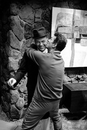 """C'mere, you big lug!"" Transman, in an uncharacteristic display of affection hugs his brother-in-law, played by Frank Sinatra. ""Let go of me or I will crush this cigarette out in your ear!"" B-I-L says."