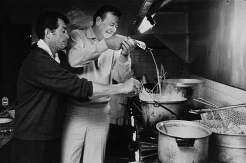 """Don't dump it in! We're supposed to add the pasta slowly!"" Transman yells at his father, played by John Wayne."
