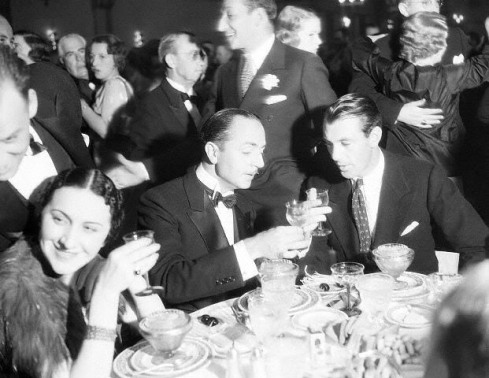 Transman and his brother Hank (played by Gary Cooper) admire the complexity of the root beer at dinner.