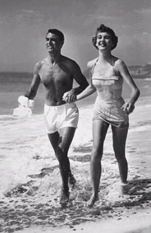 """I love the fresh salt air and my white short shorts!"" Cary Grant as Transman and the lovely Betsy Drake as his other invisible girlfriend. (Apparently, Transman is gonna be popular in 2014!)"